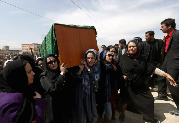 Afghan women's rights activists carry the coffin of Farkhunda, an Afghan woman who was beaten to death and set alight on fire on Thursday, during her funeral ceremony in Kabul